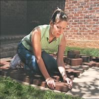 Woman Placing Brick